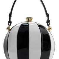 This awesome handbag features a vegan leather material on a hard dome shape body, black and white patchwork throughout. The interior is lined and has leatherette gussets at the side. Bag includes detachable shoulder straps and small handle.