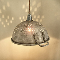 upcycled battered and weathered colander lamp