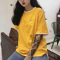 NIKE Fashion new embroidery couple short sleeve top t-shirt Yellow