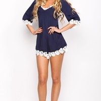 HelloMolly | Flower Girl Playsuit Navy - Floral lace detailing navy playsuit with cut out back