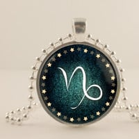 "Capricorn birth sign, Zodiac. 1"" Glass and metal Pendant necklace Jewelry."