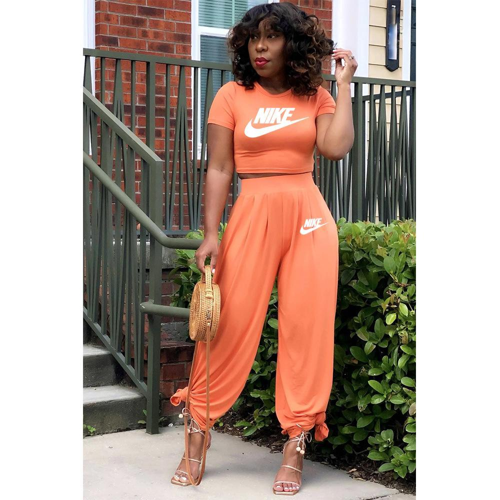 Image of NIKE women's new fashion printing casual sports suit two piece Orange