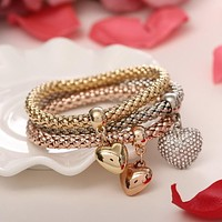 Ladies 3 Piece Elastic Bracelet Trio With Charms