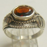 A unique Sterling and genuine Garnet ring previously witch owned.