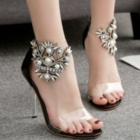 The new pearl horse eye glass flowers with PVC film peep-toe sandals