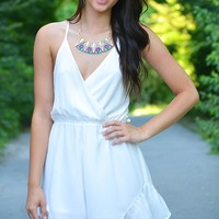 Over and Over Romper -  sleeveless chiffon romper in white featuring an open strappy back and ruffle trim shorts