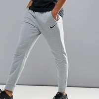 Nike Training Dri-FIT fleece tapered joggers in grey 860371-063 at asos.com