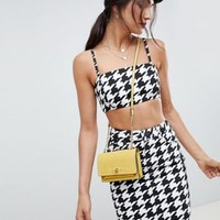 ASOS DESIGN denim crop top with skinny straps in houndstooth at asos.com