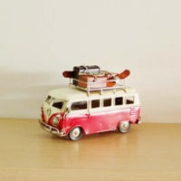 Red and white VW van, retro collectible metal VW van miniature, with suitcases, skates and rackets on the bagage rack, art supplies,