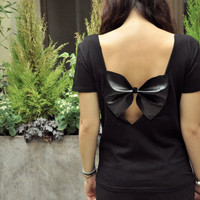 ESTHER (back less black tee-shirt with a black big bow)