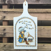 """Vintage cutting board wall art Victorian girl in bonnet listening to a phonograph """"Start each day with a song in your heart """" blue & yellow"""