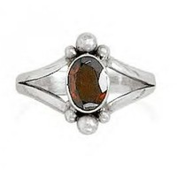 Oval Faceted Garnet Ring With Split Style Bead Design Band