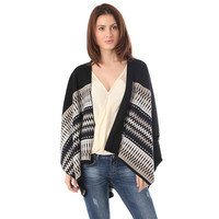 Black geo-tribal cape in knitted fabric