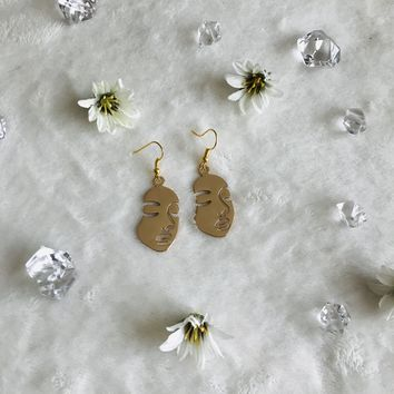 Solid Woman's Facial Silhouette Earrings