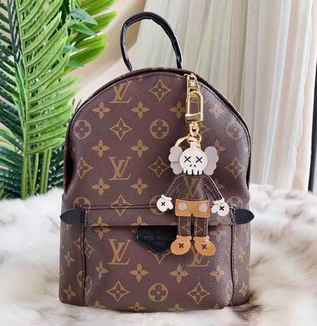 Image of Louis Vuitton LV x Kaws Charm And Key Holder