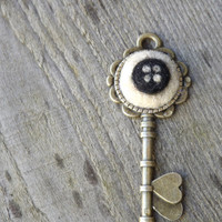 Coraline key pendant with black button, bronze key charm with needle felted badge eye