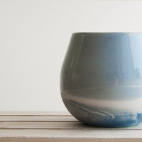 Ceramic cup in light blue and white with glossy glaze. modern and urban look. Great for drinks and desserts