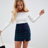 ASOS DESIGN navy plaid mini skirt with asymmetric zip at asos.com