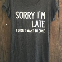 SORRY I'M LATE TEE IN CHARCOAL