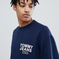 Tommy Jeans small chest logo crewneck sweatshirt relaxed regular fit in navy at asos.com