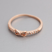 Tiny embraced Infinity ring detailed with CZ( Cubic Zirconia) Setting Ring in Pink Gold Color