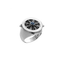 Dharmachakra Sterling Silver and Blue Topaz Noble Truth Turn Ring