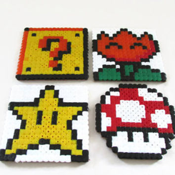 SuperMario drinks coasters, hama / perler bead coasters featuring 1 up mushroom , star, item box and power flower, video game pixel art