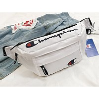 Champion sells women's casual Fanny packs in a stylish canvas print chest-straddling bag White