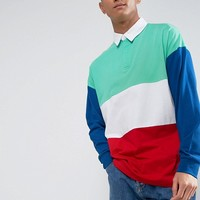 ASOS Oversized Long Sleeve Rugby Shirt With Primary Colour Block at asos.com