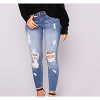 Women's fashion high-elastic nine-point hole jeans