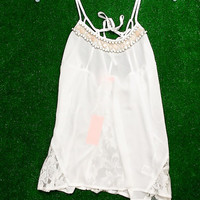 READ BETWEEN THE LACE CHIFFON TANK IN WHITE