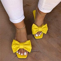 New large size one-line solid color bow ladies flat sandals slippers