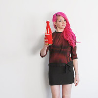 a warm hi hello from me and my booze . knit bottle cozy