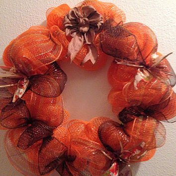 Fall wreath, made with deco mesh in lots of fall colors 22 inches.
