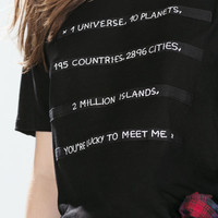 T-shirt with ribbons and text