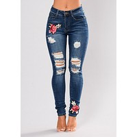 Fashion hole embroidered high-elastic denim women's trousers