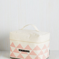 Reaching a Swift Illusion Makeup Bag by Disaster Designs from ModCloth