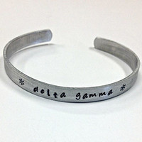 Delta Gamma Cuff Bracelet - handstamped in a whimsical font on a non tarnish aluminum cuff, officially licensed