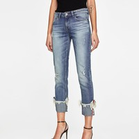 Z1975 JEANS WITH UNEVEN HEMS AND PEARL BEADS DETAILS