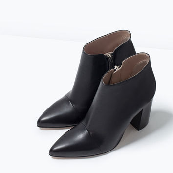 Pointy high heeled leather boots