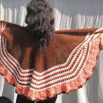 Pink, brown and white crocheted cape.