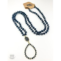 BLACK CRYSTAL NECKLACE WITH GOLD TONE AND BLACK RHINESTONE PENDANT