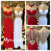Fitted High Neck Illusion Prom Gown With Beaded Waist And Keyhole Back