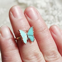 Turquoise butterfly  ring  above  knuckle   ring  wedding ring