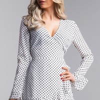 AKIRA Long Ruffle Sleeve Wrap Front Polka Dot Romper in Navy, White