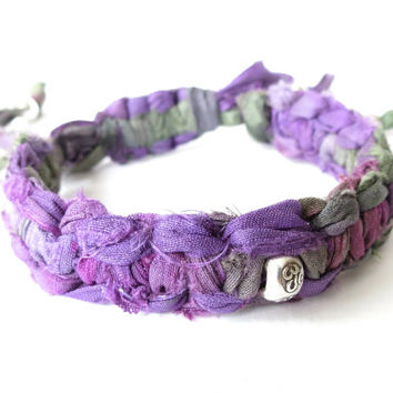 Sari silk ribbon bracelet with Sterling silver beads, purple iris recycled fabric from Nepal, om charm