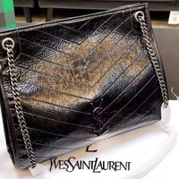 YSL sells retro women's one-shoulder makeup bags in solid leather