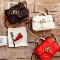 Gucci sells ladies'double G fashion quilted V-type leather mini-handbag shopping bag