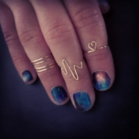 KNUCKLE RINGS- spiral, life line, heart