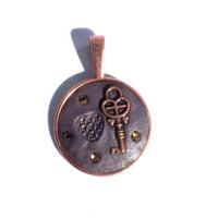 Key to my Heart, Copper Bezel with Crystal Clay Embellished with a Key, Amber Swarovski Crystals with an Impression of a Heart